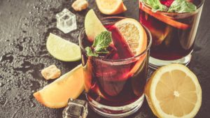 Sangria and ingredients on stone background, copy space