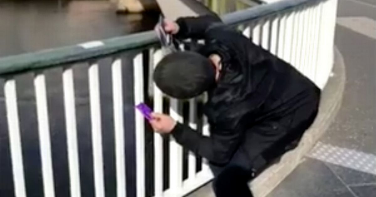 Drunk Man Tries To Withdraw Cash From Fence