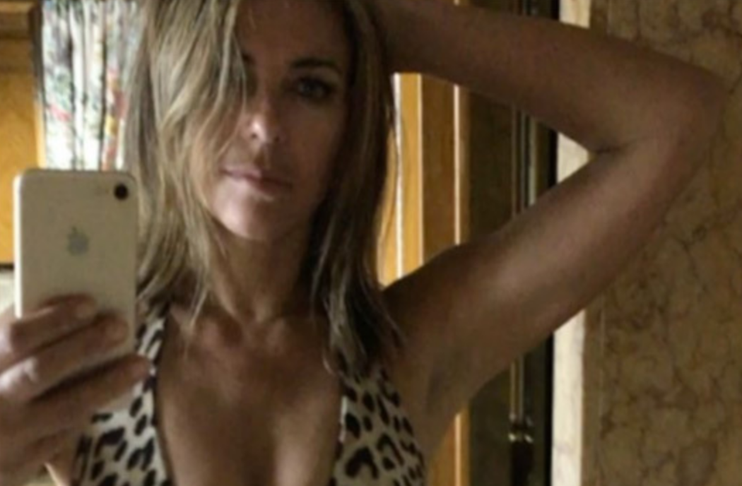 52 Year Old Elizabeth Hurley Shakes Her Booty in a Sexy Leopard Swimsuit