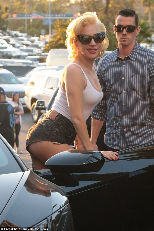 Lady Gaga Flaunts Her Ample Curves in a Tight White Shirt for the World Series [PICS]
