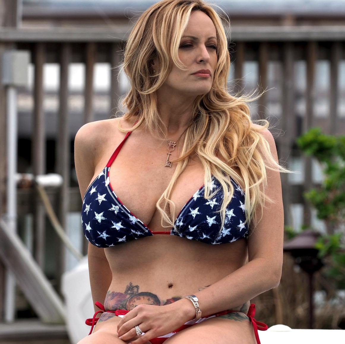 Stormy Daniels Shows Her Busty Cleavage in Stars and Stripes Bikini [SFW PICS]