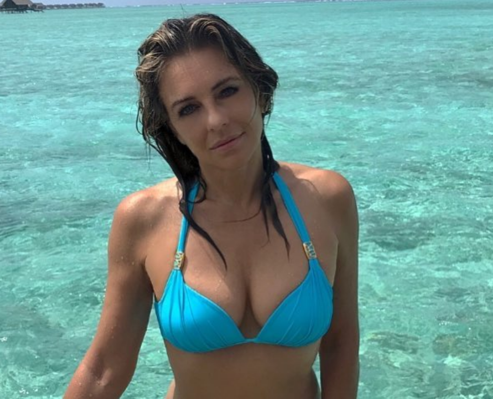 Elizabeth Hurley, 52, Smoulders for the Camera in a Very Busty Blue Bikini [SFW PIC]