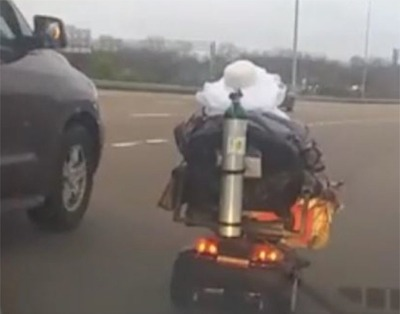 An Elderly Woman Hits The Road On Her Scooter