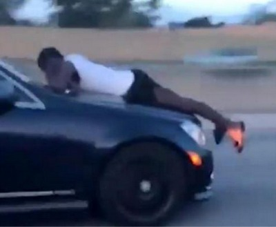 Crazy Video Of A Guy Riding On The Hood Of A Car Going 70 Miles An Hour!