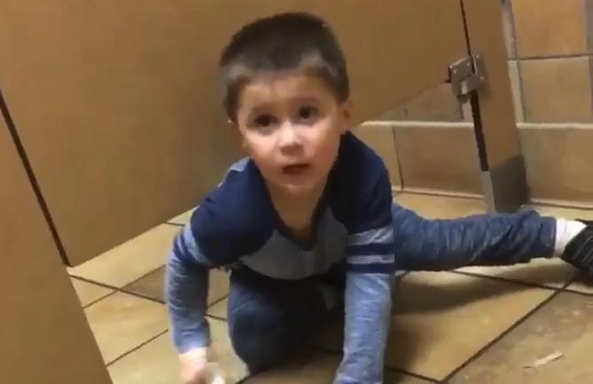 WATCH Boy Crawls Into Strangers Bathroom Stall To Ask For Help - Boy crawls under bathroom stall