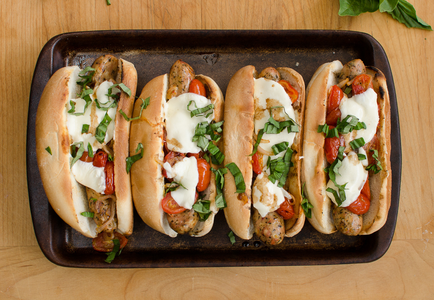 Grilled Caprese Dogs with Garlic Bread Buns and Balsamic