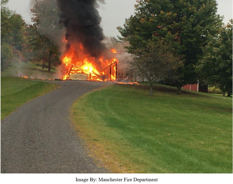 UPDATE: Manchester fire under investigation, motorist credited with carrying elderly resident to safety