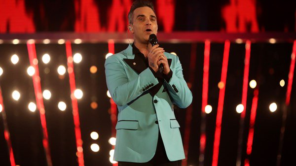 Robbie Williams booked to open World Cup despite offending Russia with song.