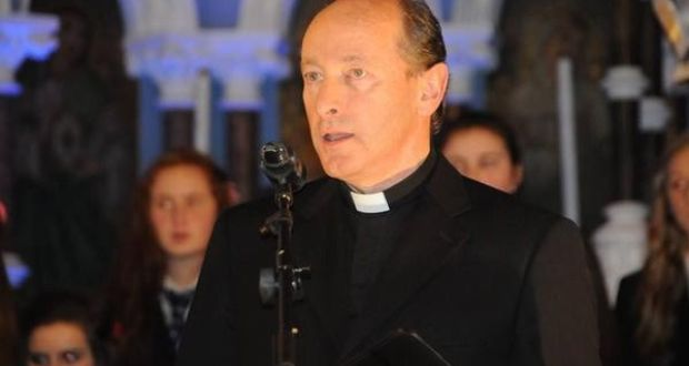 Bishop compares Minister John Halligan sponsoring Godson at Conformation to having Kilkenny hurling Manager Brian Cody playing on goal for Waterford