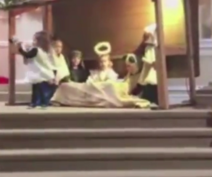 Two-year-old dances with baby Jesus during children's nativity performance