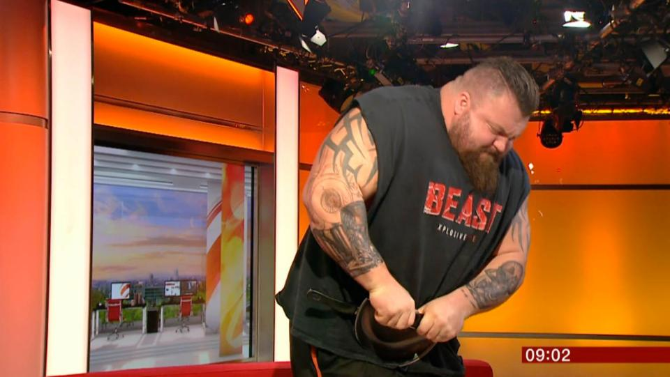 Man Bends Frying Pan, Bench Presses Person on Television
