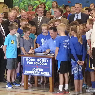 Walker signs state budget in Neenah