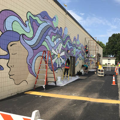 Students paint mural for service program