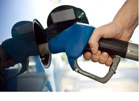Price of gas down less than a cent
