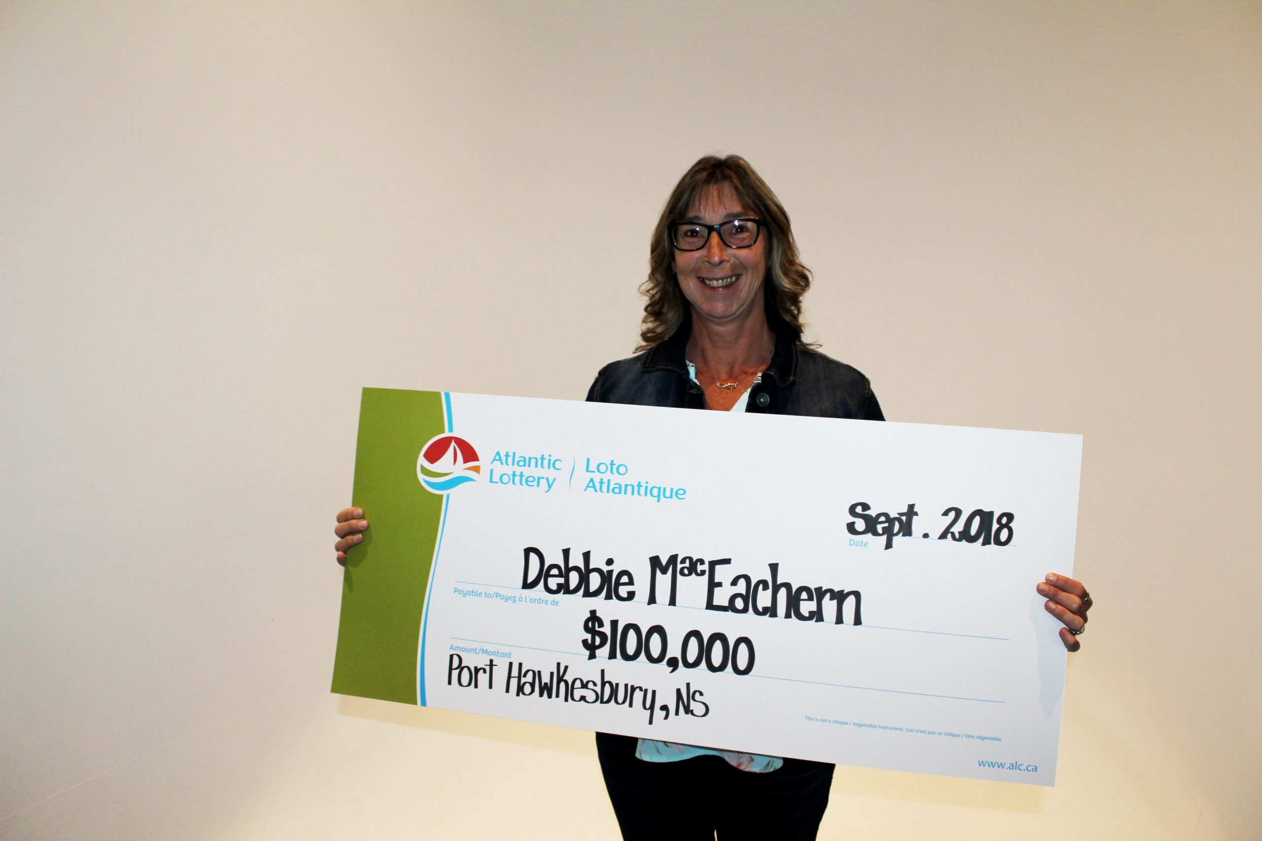 Local lotto winner claims prize