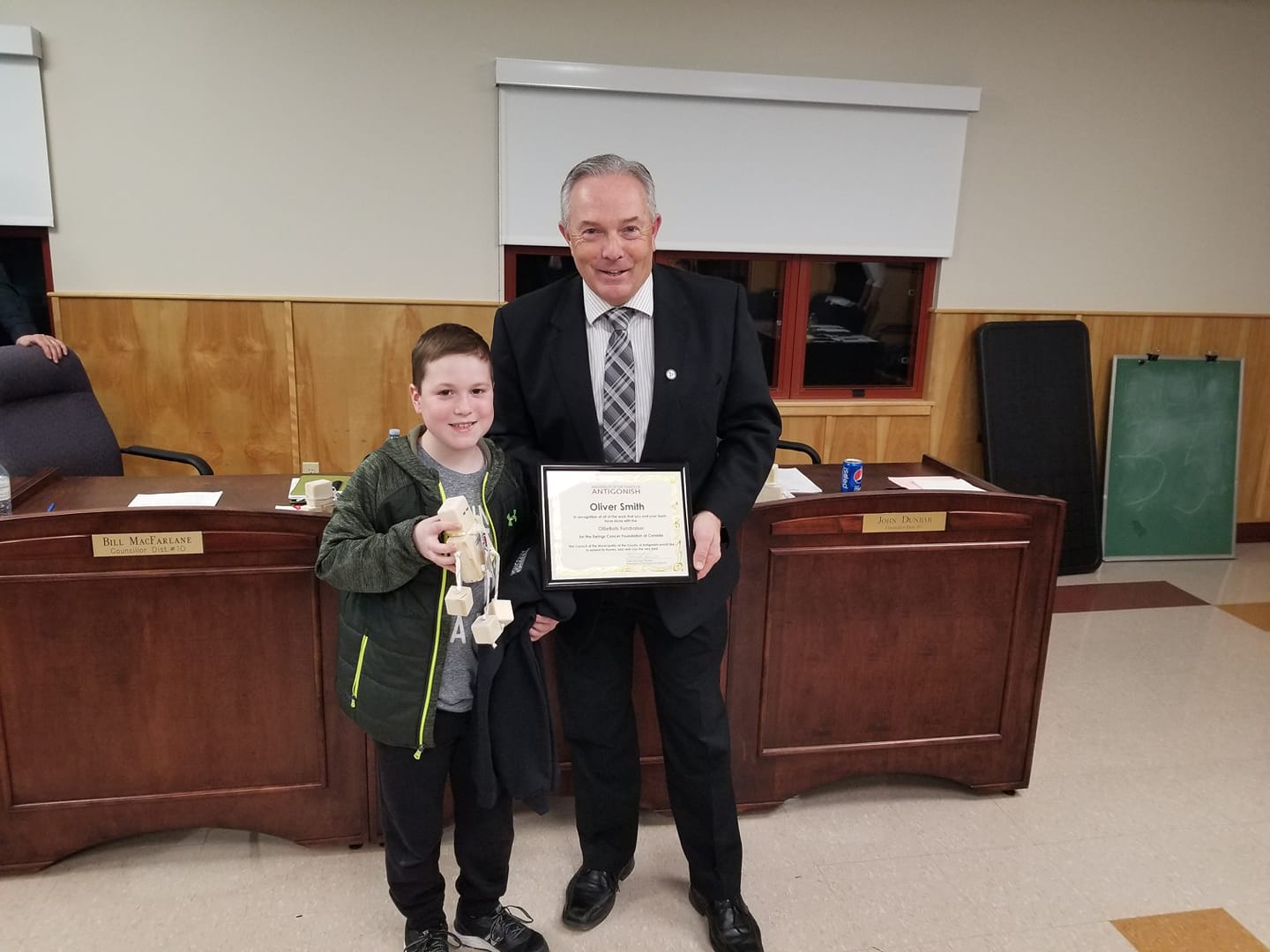Local boy presents OllieBots to municipal councillors