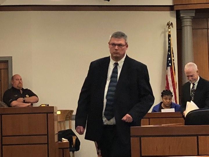 Tucker arraigned, bond reduced