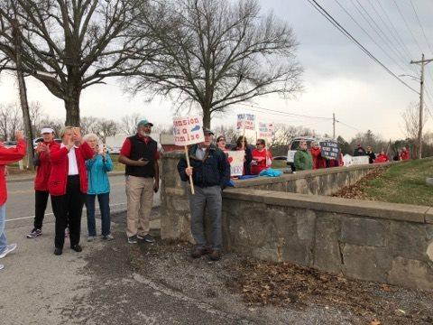 Bevin met by protestors at Trigg County High School visit