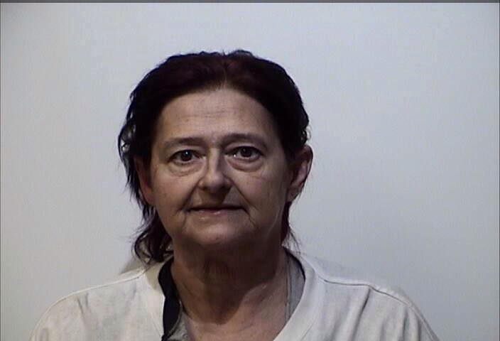 Woman served with felony theft indictment