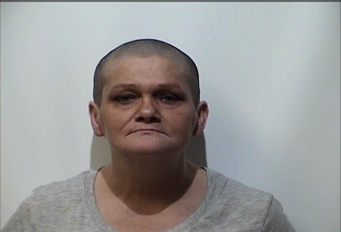 Woman served with warrant for burglary