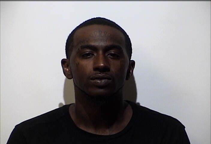 Man arrested for fake money, gun, warrants