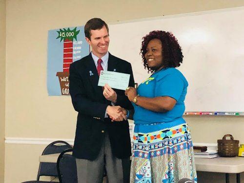 Attorney General presents check to Children's Advocacy Center
