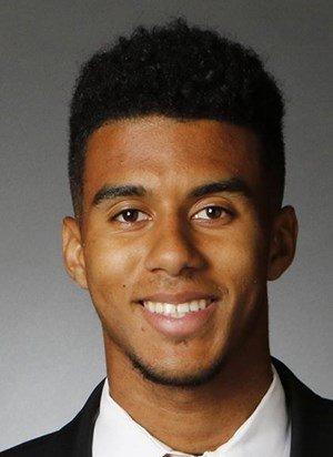 U of L quarterback Travis to transfer