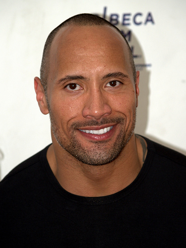 The Rock feeds girlfriend while she breastfeeds their daughter!