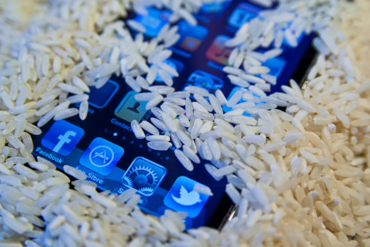 The Trick To Fixing A Wet Phone That's Even Better Than Rice