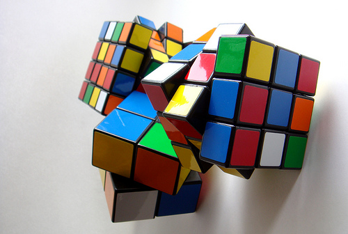 Teen Solves Three Rubik's Cubes At Once For Guinness Record!