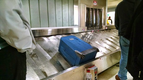 VIDEO: A Woman Boards a Luggage Conveyor Belt Thinking It's the Way