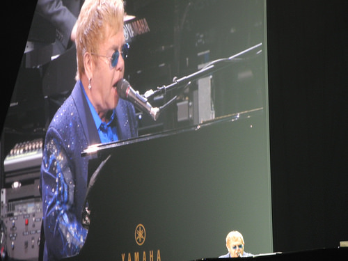 Elton John Hit in the Face with Beads!