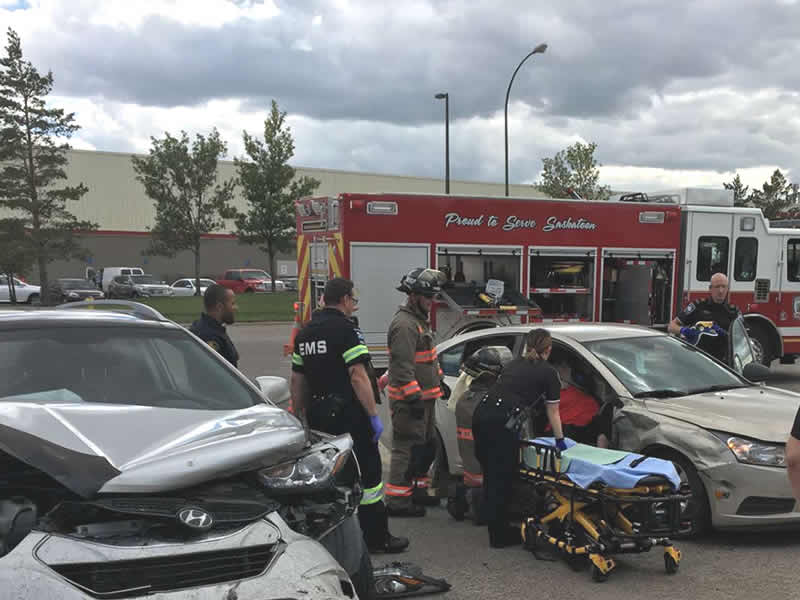 Fire Crew Extracts Woman From Vehicle