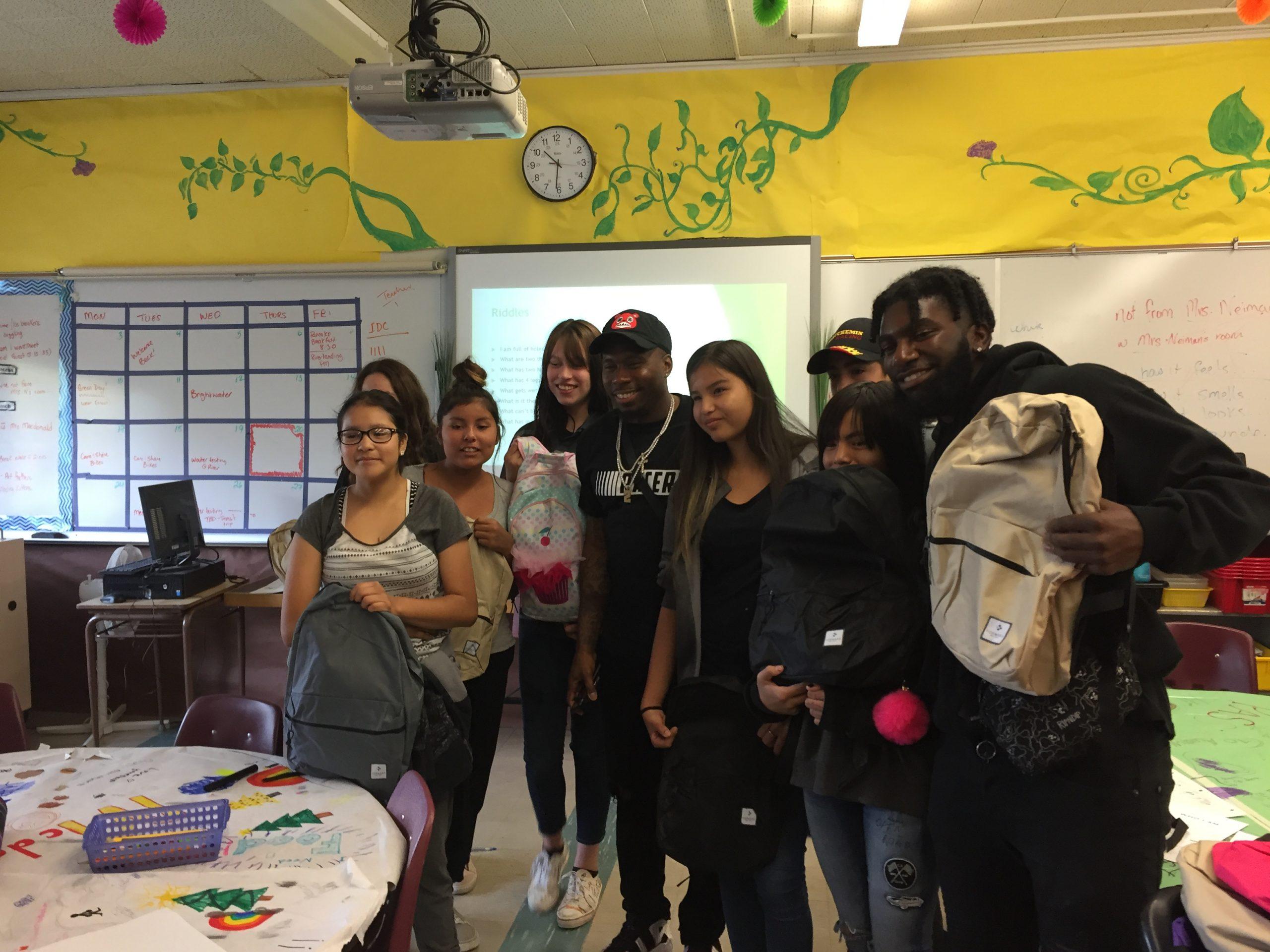 Roughriders Donate Backpacks to Students at Princess Alexandra