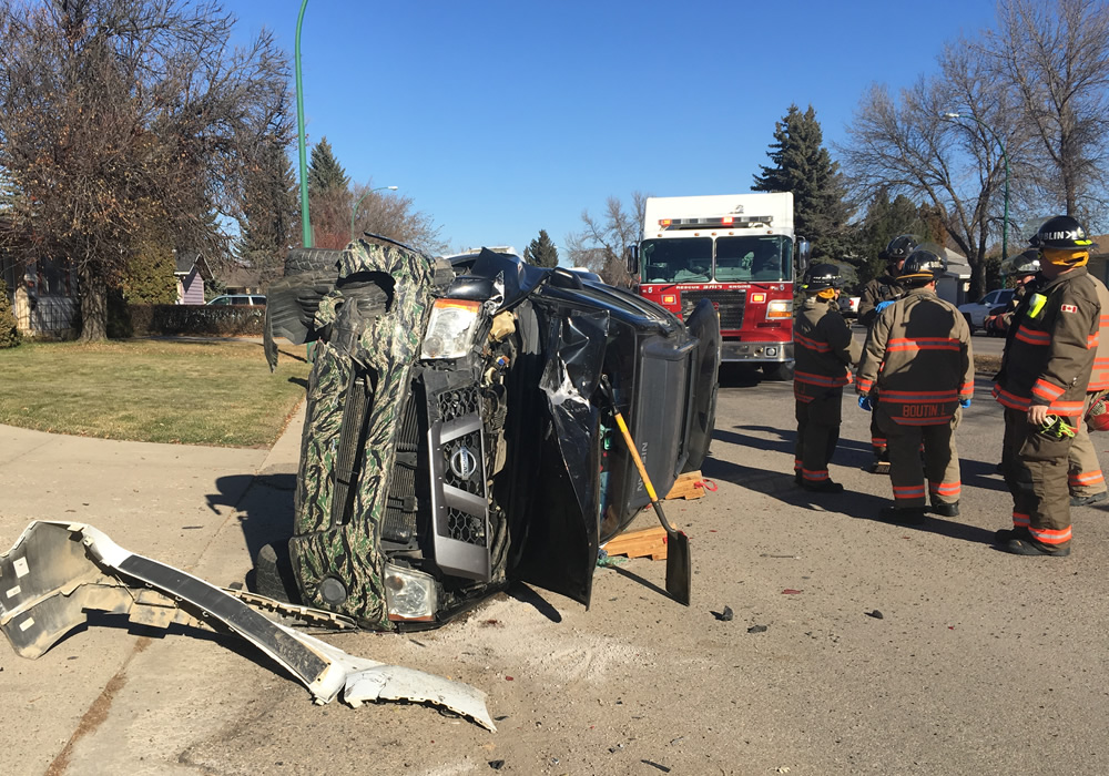 Fire Department Extracts Someone From Overturned Vehicle