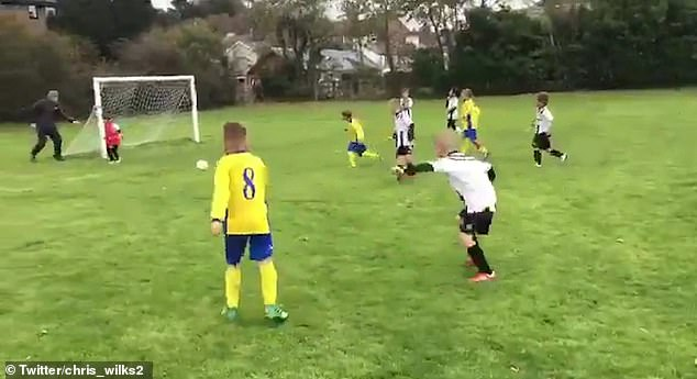 Dad Pushes His Soccer-Playing Son in Front of the Ball to Make a Save