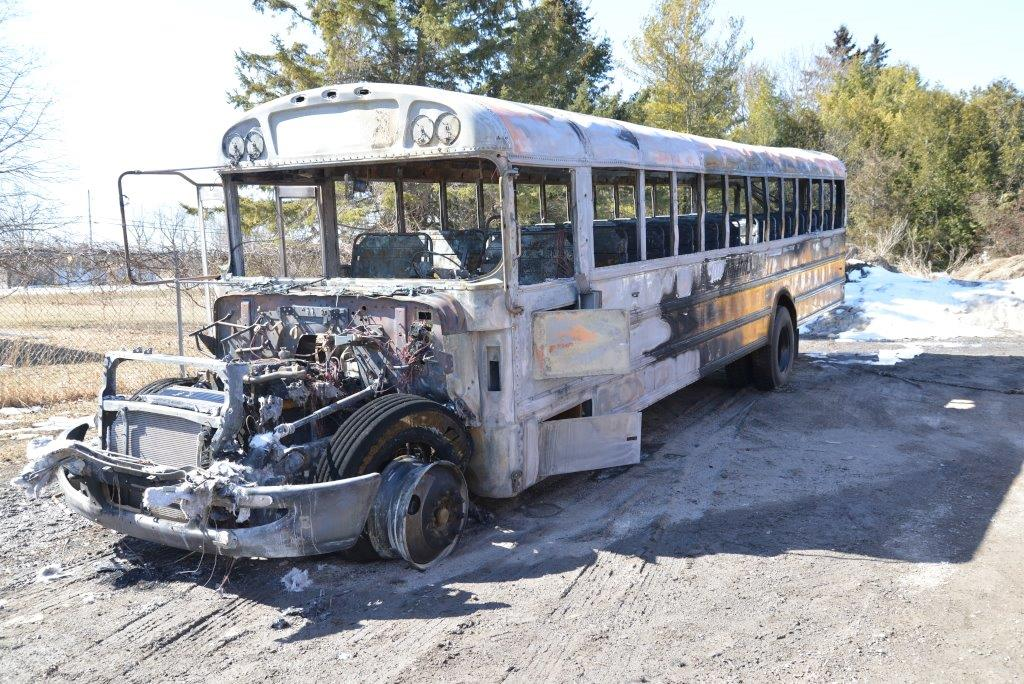 Six youths charged with burning school bus