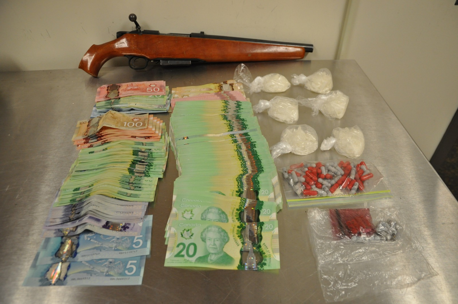 Drug bust nets a weapon, four charged