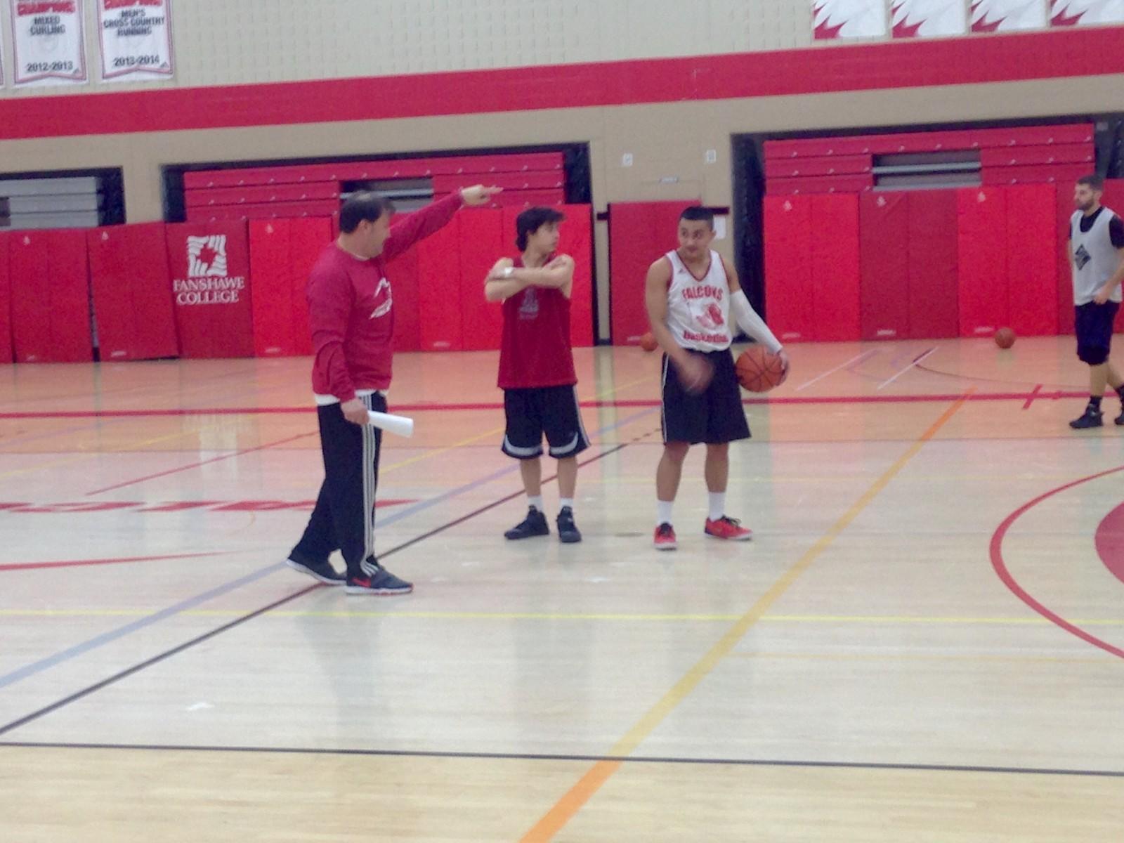 Fanshawe Falcons Men's Basketball team regroup.