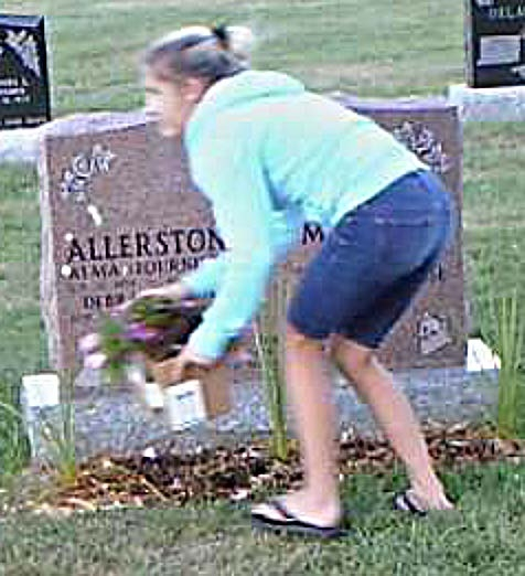 Police searching for woman stealing items from a grave