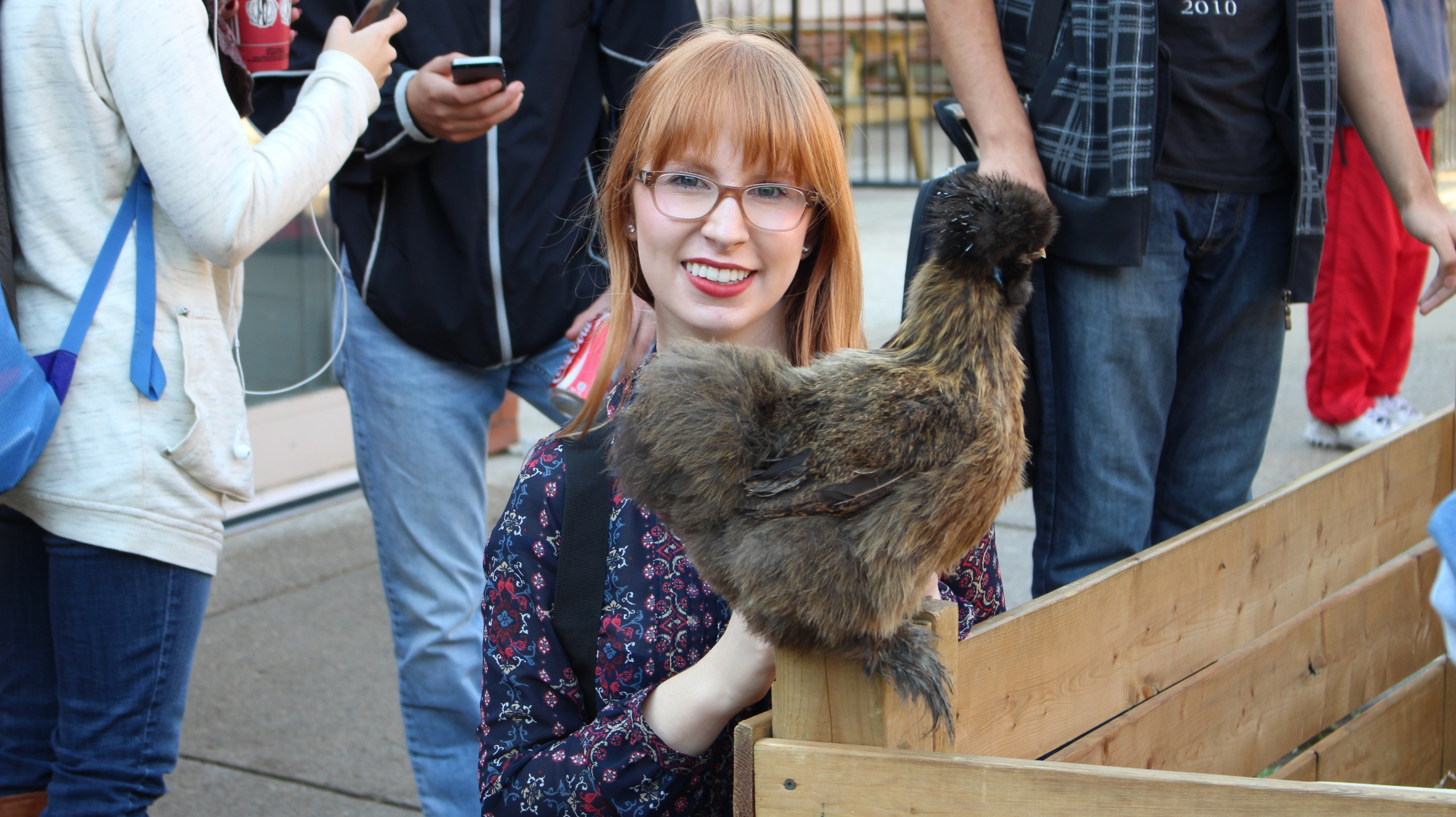 Fanshawe students get cuddly with the Little Track's petting zoo