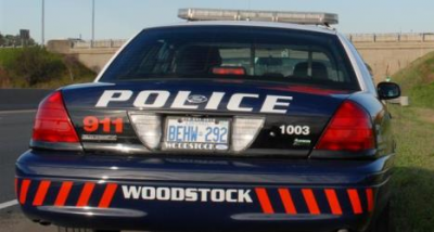 Driver charged after collision in front of Woodstock Police HQ