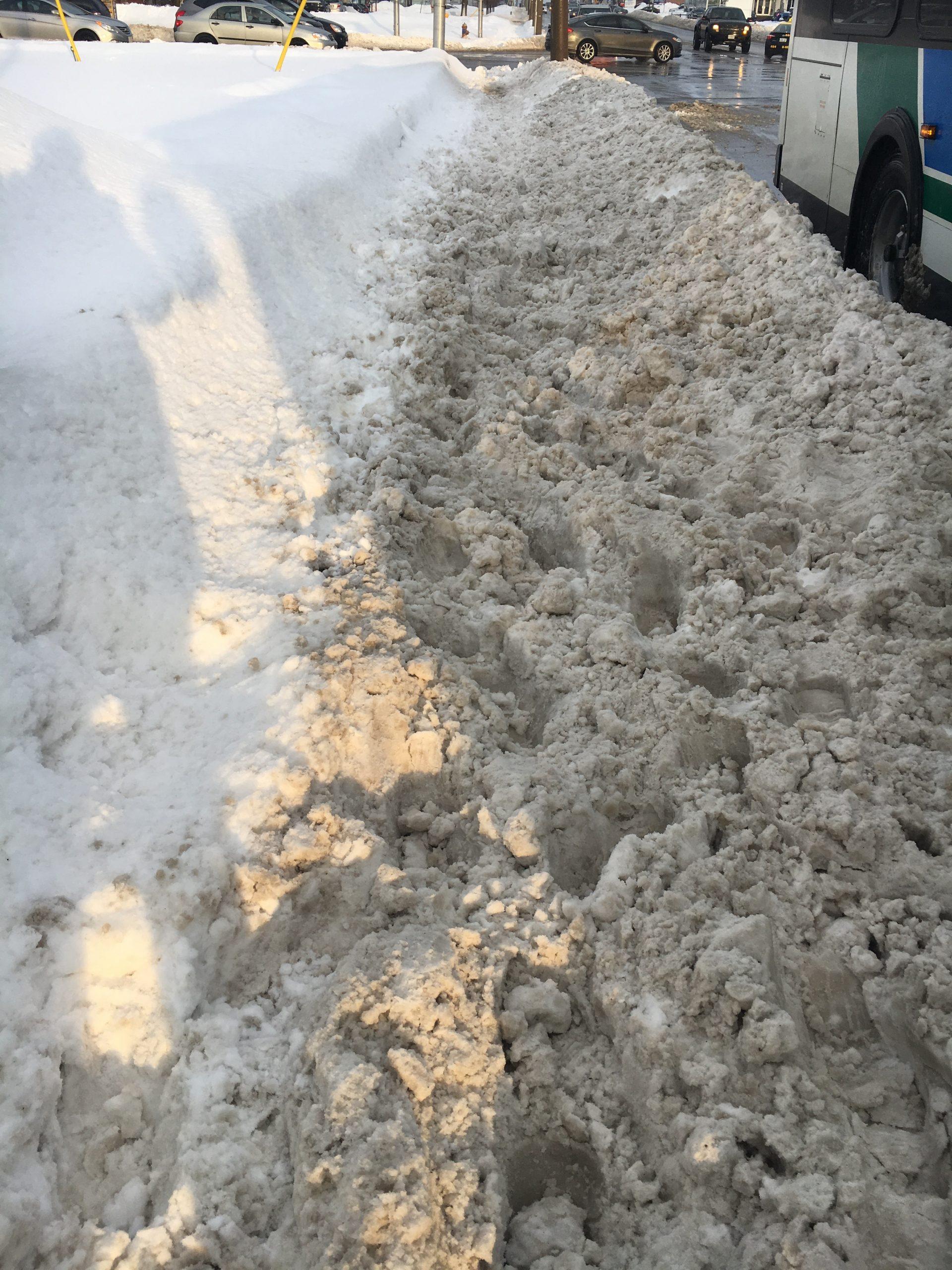 Pedestrians struggle with snow-filled sidewalks