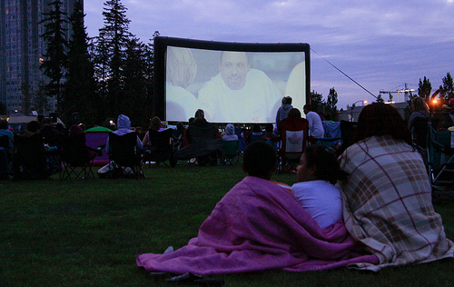 Enjoy free movies in the park with neighbourhood friends!