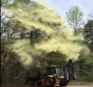 AAAACHOOOO!!!!! Guy Sets Off Pollen Bomb With A Backhoe