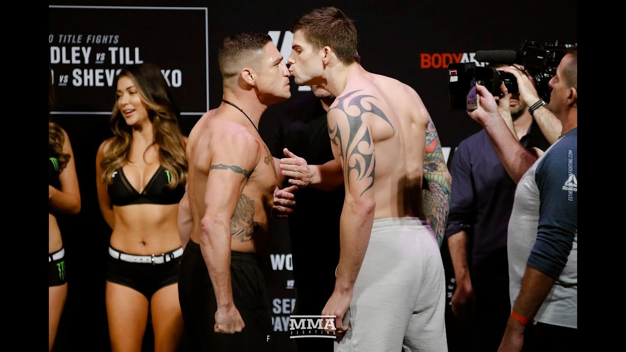 UFC Fighter kisses opponent at weigh-in!