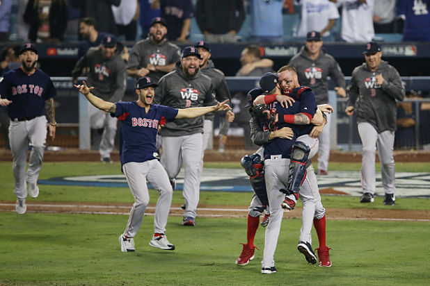 Red Sox Players Catch, Chug Beers From Fans During World Series Parade