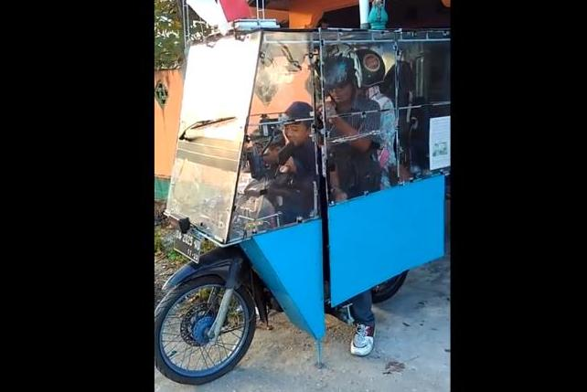 Man Converts Motorcycle Into Fully Enclosed Vehicle
