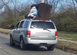 Ohio Man Stands on SUV to Hold Couch Still During Move