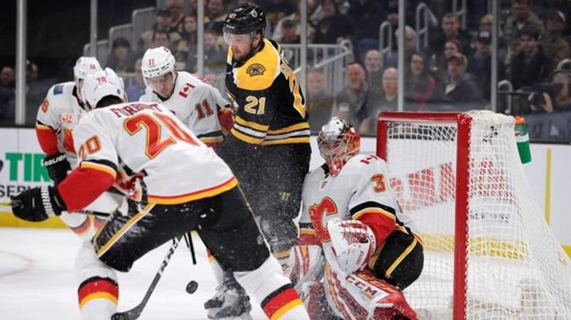 Flames end Bruins' home winning streak